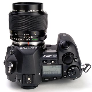 Shown: an E-1 with OM Zuiko 90 mm F/2 Macro lens.